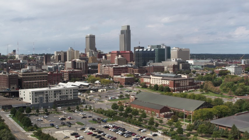5.7K stock footage aerial video of flying by the city's skyline in Downtown Omaha, Nebraska Aerial Stock Footage | DX0002_168_004