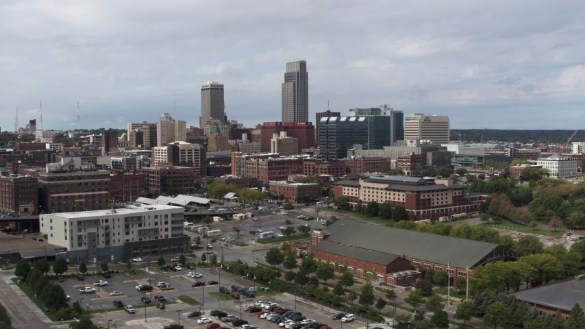 5.7K stock footage aerial video of passing by the city's skyline in Downtown Omaha, Nebraska Aerial Stock Footage | DX0002_168_005