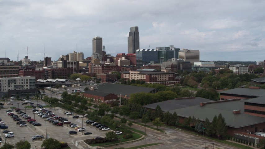 5.7K stock footage aerial video descend with view of the downtown skyline in Downtown Omaha, Nebraska Aerial Stock Footage | DX0002_168_007