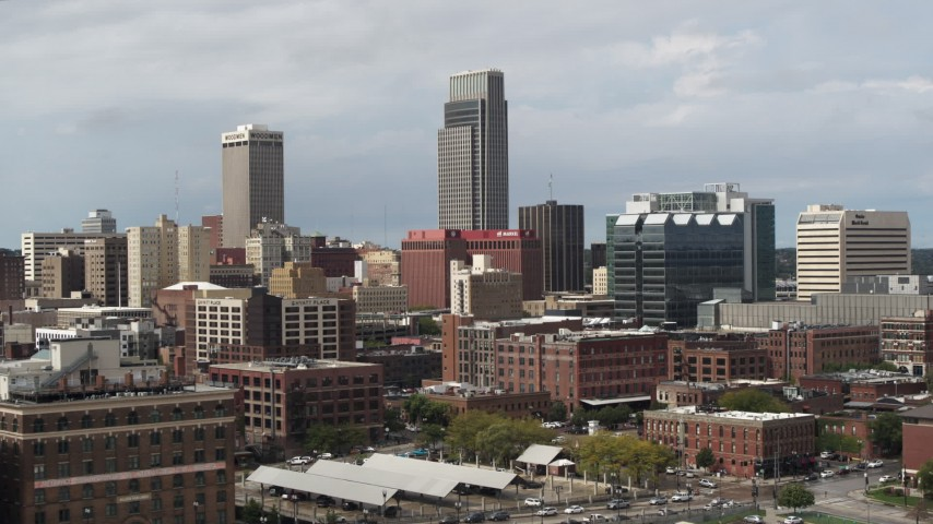5.7K stock footage aerial video of flying by skyscraper and downtown skyline in Downtown Omaha, Nebraska Aerial Stock Footage | DX0002_168_009