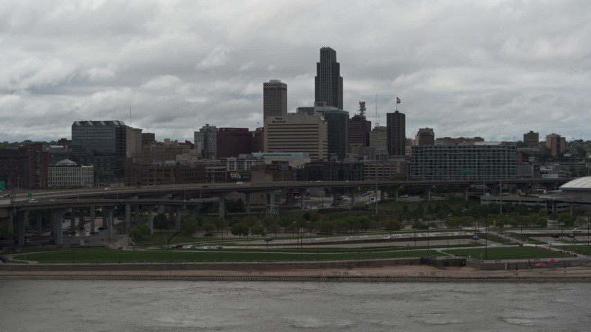 5.7K stock footage aerial video ascend from Missouri River toward the city skyline, Downtown Omaha, Nebraska Aerial Stock Footage | DX0002_168_014