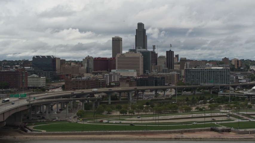 5.7K stock footage aerial video of a reverse view of the city skyline from riverfront park, Downtown Omaha, Nebraska Aerial Stock Footage | DX0002_168_019