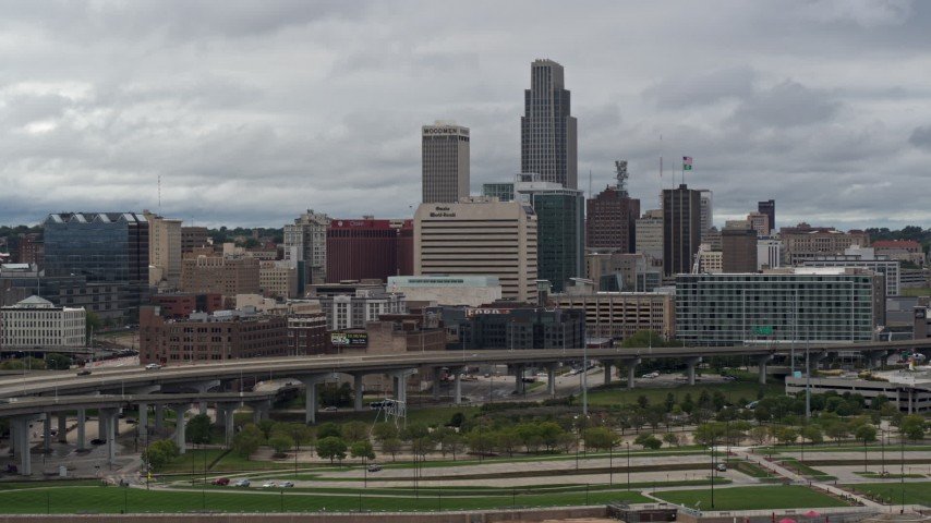 5.7K stock footage aerial video of the city skyline seen from riverfront park, Downtown Omaha, Nebraska Aerial Stock Footage | DX0002_169_001