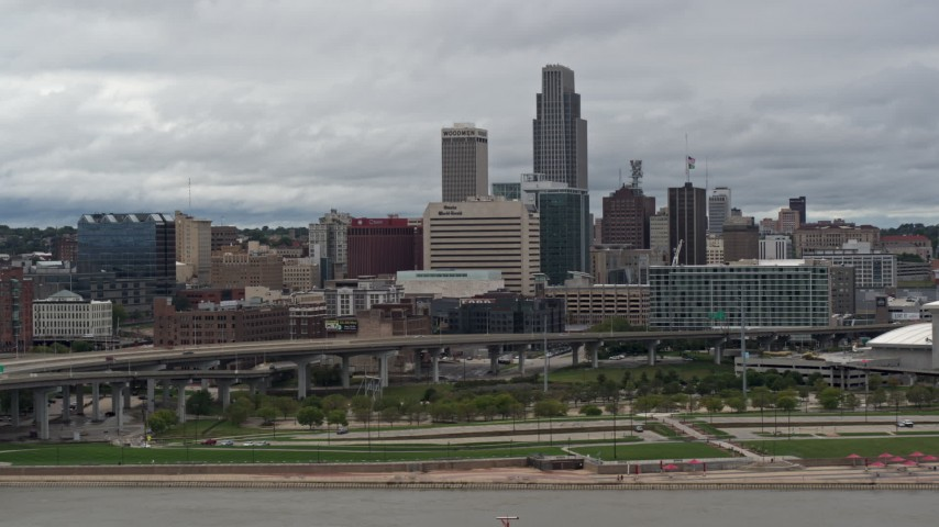 5.7K stock footage aerial video of flying by a riverfront park with a view of skyline, Downtown Omaha, Nebraska Aerial Stock Footage | DX0002_169_002