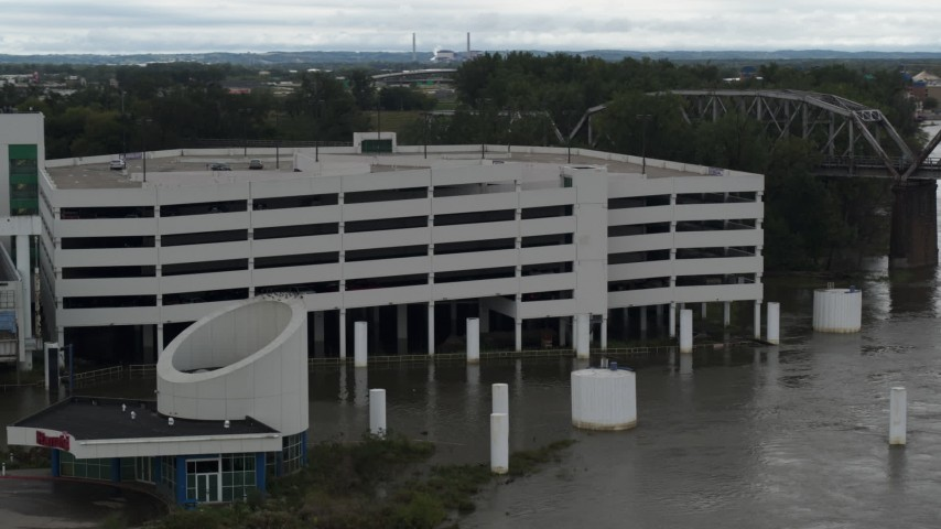 5.7K stock footage aerial video of orbiting a flooded parking garage in Council Bluffs, Iowa Aerial Stock Footage | DX0002_169_012