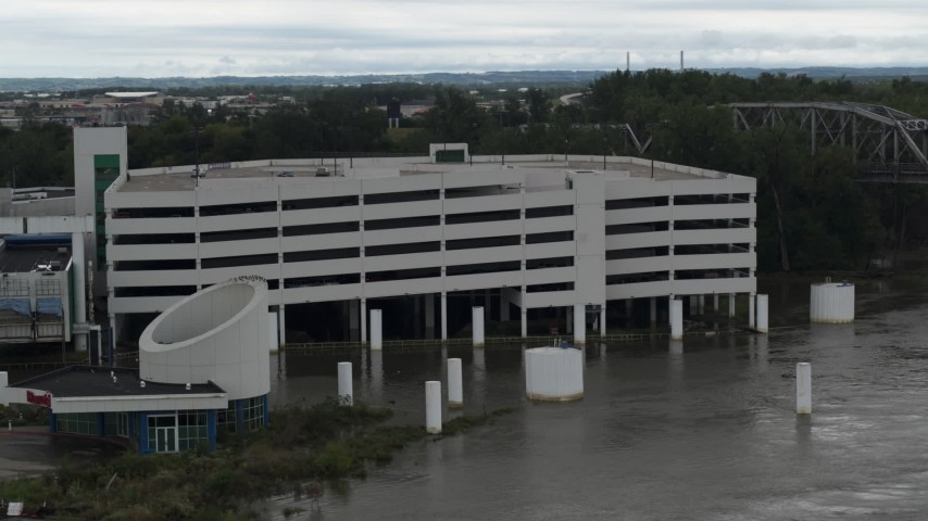 5.7K stock footage aerial video orbit a flooded parking garage in Council Bluffs, Iowa Aerial Stock Footage | DX0002_169_013