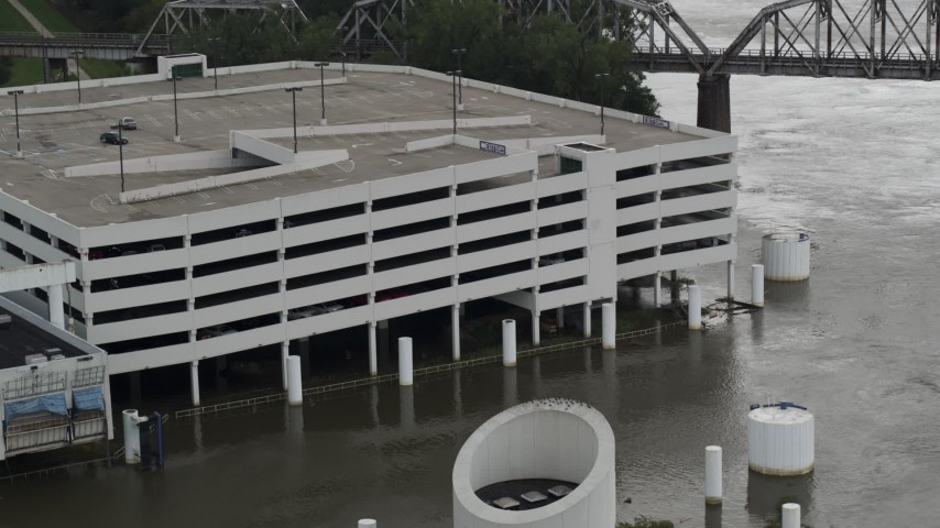 5.7K stock footage aerial video of circling a flooded parking garage in Council Bluffs, Iowa Aerial Stock Footage | DX0002_169_015