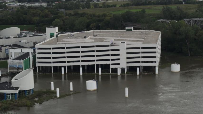 5.7K stock footage aerial video orbit around a flooded parking garage in Council Bluffs, Iowa Aerial Stock Footage | DX0002_169_016