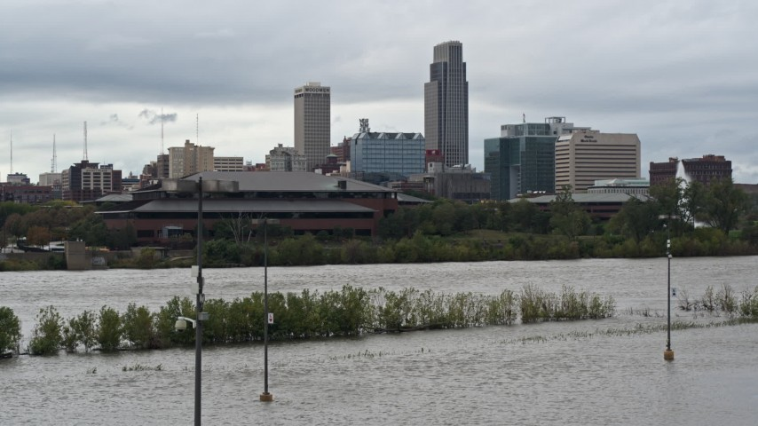 5.7K stock footage aerial video of Missouri River and riverfront park with view of skyline, Downtown Omaha, Nebraska Aerial Stock Footage | DX0002_169_022