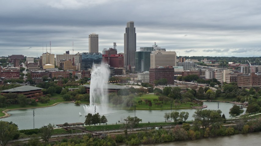 5.7K stock footage aerial video of the city's skyline while flying by a park fountain, Downtown Omaha, Nebraska Aerial Stock Footage | DX0002_169_030