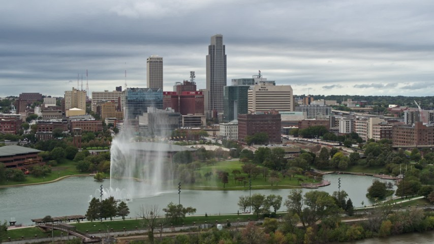 5.7K stock footage aerial video of the city's skyline while passing a park fountain, Downtown Omaha, Nebraska Aerial Stock Footage | DX0002_169_031