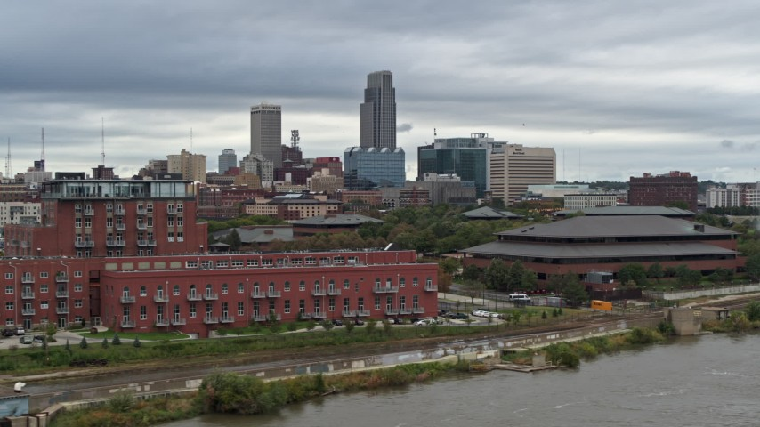 5.7K stock footage aerial video of the city's skyline and riverfront apartment complex seen from river, Downtown Omaha, Nebraska Aerial Stock Footage | DX0002_169_035
