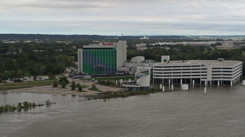 5.7K stock footage aerial video of the hotel and casino in Council Bluffs, Iowa, seen from the river Aerial Stock Footage | DX0002_169_038