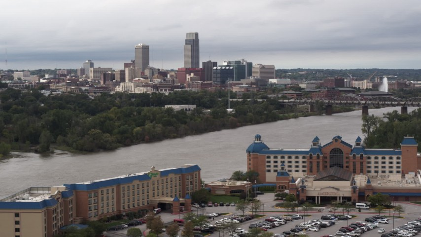 5.7K stock footage aerial video of the city's skyline seen from across the Missouri River, Downtown Omaha, Nebraska Aerial Stock Footage | DX0002_170_001