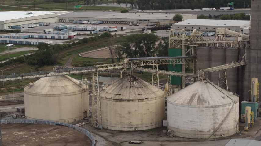 5.7K stock footage aerial video storage tanks and grain elevator in Council Bluffs, Iowa Aerial Stock Footage | DX0002_170_005