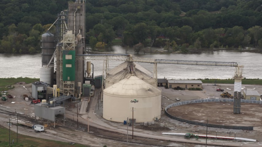5.7K stock footage aerial video a reverse view of storage tanks and grain elevator by river, Council Bluffs, Iowa Aerial Stock Footage | DX0002_170_008
