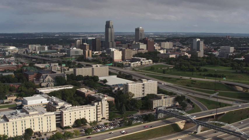 5.7K stock footage aerial video of the city's skyline seen from university and apartment complex, Downtown Omaha, Nebraska Aerial Stock Footage | DX0002_170_010