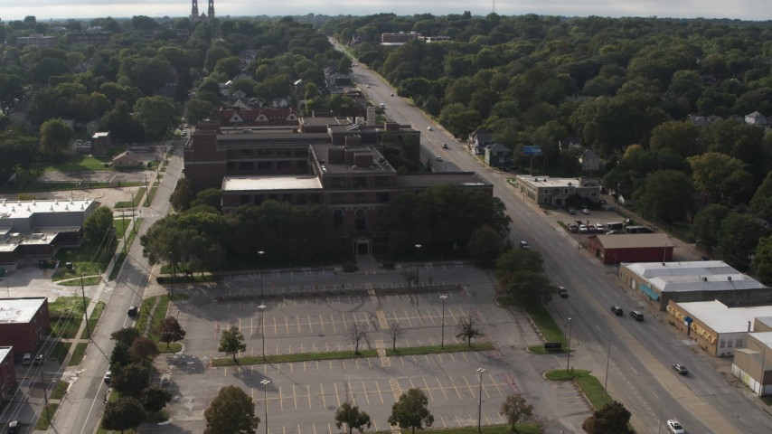 5.7K stock footage aerial video view of Omaha Adult High School and Cuming Street in Omaha, Nebraska Aerial Stock Footage | DX0002_170_016