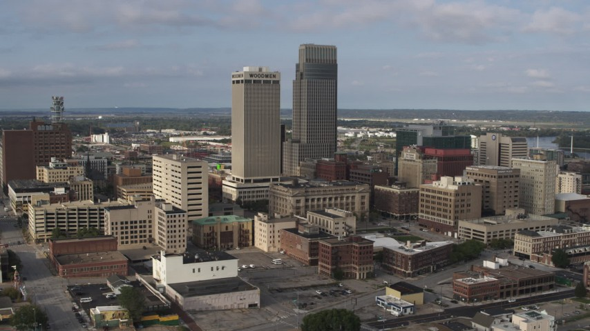 5.7K stock footage aerial video of flying by skyscrapers towering over city buildings in Downtown Omaha, Nebraska Aerial Stock Footage | DX0002_170_022