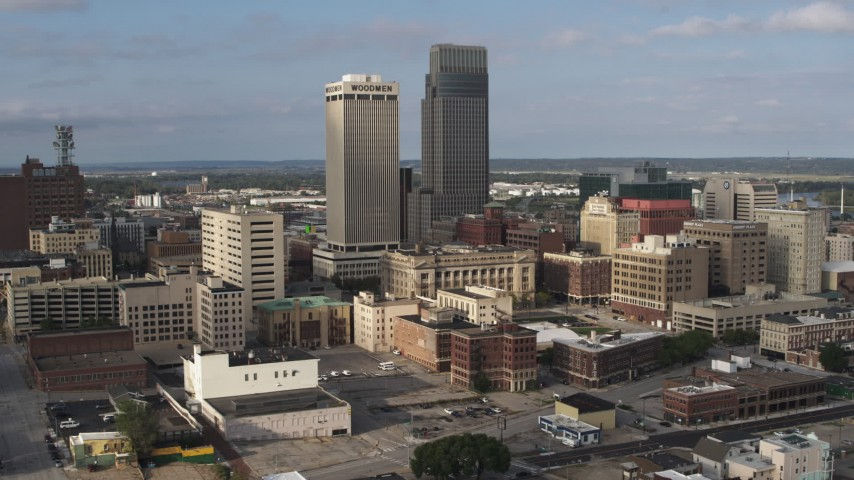 5.7K stock footage aerial video of slowly orbiting skyscrapers towering over city buildings in Downtown Omaha, Nebraska Aerial Stock Footage | DX0002_170_024