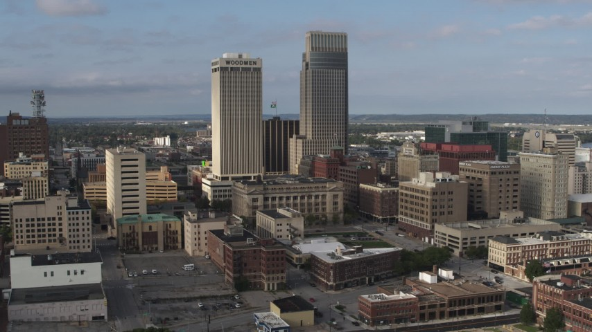 5.7K stock footage aerial video of a stationary view of skyscrapers towering over city buildings in Downtown Omaha, Nebraska Aerial Stock Footage | DX0002_170_025