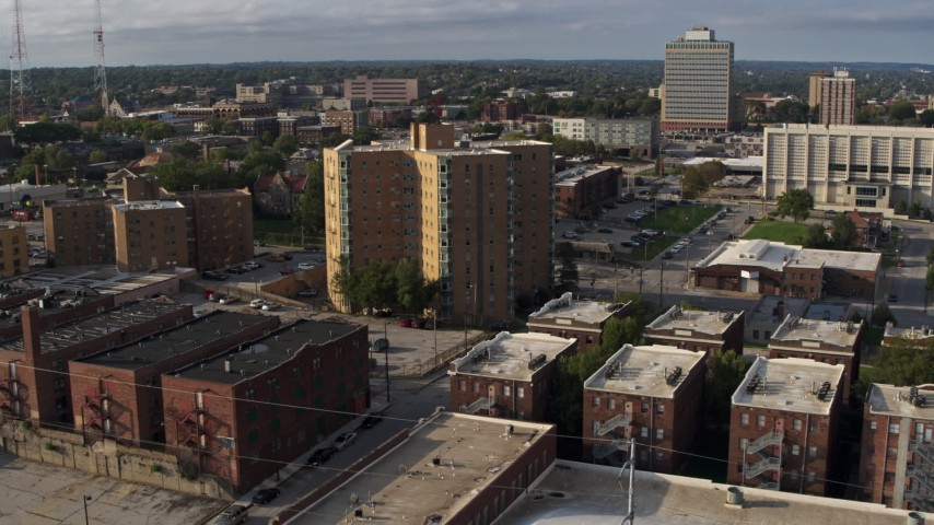 5.7K stock footage aerial video flying away from an apartment building in Omaha, Nebraska Aerial Stock Footage | DX0002_170_034