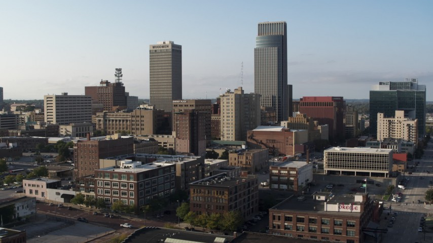5.7K stock footage aerial video ascend with view of the city's skyscrapers in Downtown Omaha, Nebraska Aerial Stock Footage | DX0002_170_037