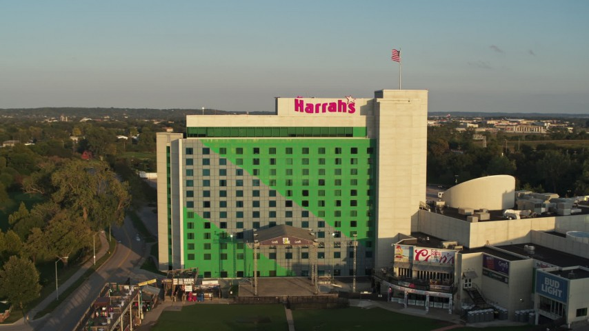 5.7K stock footage aerial video of a reverse view of the hotel and casino at sunset in Council Bluffs, Iowa Aerial Stock Footage | DX0002_172_003