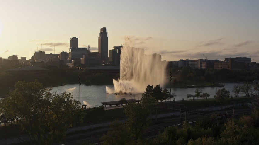 5.7K stock footage aerial video stationary view of a fountain with view of skyline at sunset, Downtown Omaha, Nebraska Aerial Stock Footage | DX0002_172_007