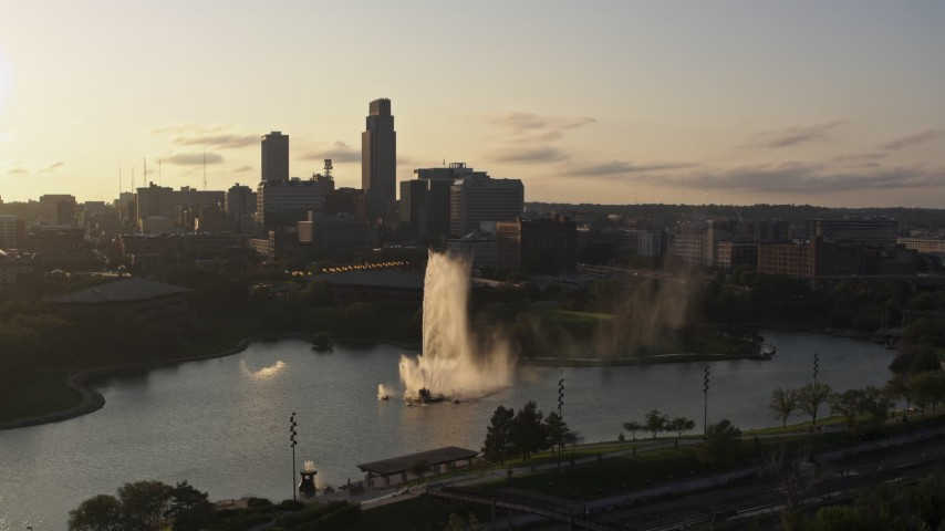 5.7K stock footage aerial video ascending away from a fountain with view of skyline at sunset, Downtown Omaha, Nebraska Aerial Stock Footage | DX0002_172_008