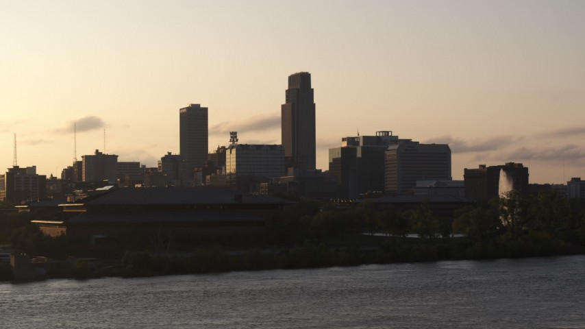 5.7K stock footage aerial video the skyline at sunset, seen from the river, Downtown Omaha, Nebraska Aerial Stock Footage | DX0002_172_011