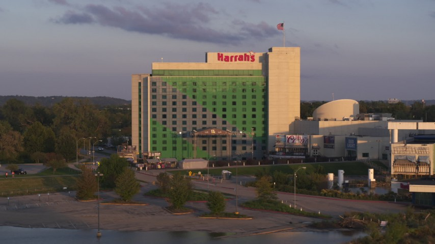 5.7K stock footage aerial video descend and orbit the hotel and casino at sunset in Council Bluffs, Iowa Aerial Stock Footage | DX0002_172_019