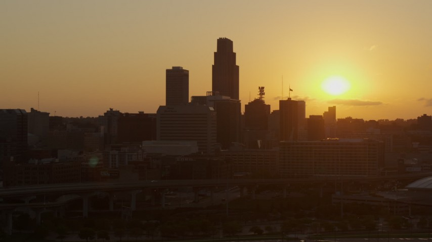 5.7K stock footage aerial video orbit skyscraper and skyline with view of setting sun, Downtown Omaha, Nebraska Aerial Stock Footage | DX0002_172_023