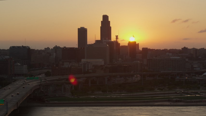 5.7K stock footage aerial video slowly circle the skyline, setting sun in background, Downtown Omaha, Nebraska Aerial Stock Footage | DX0002_172_032
