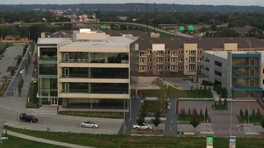5.7K stock footage aerial video of circling a modern office building at sunset in Council Bluffs, Iowa Aerial Stock Footage | DX0002_172_034