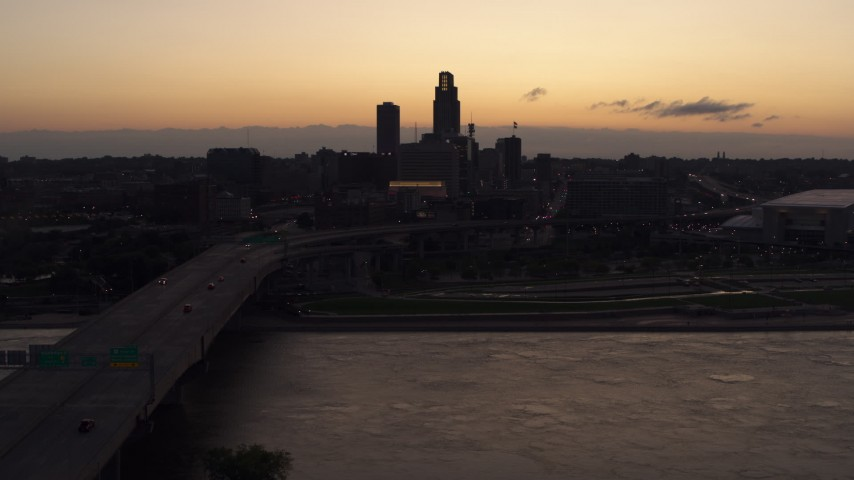 5.7K stock footage aerial video approach skyline from bridge over the river at twilight, Downtown Omaha, Nebraska Aerial Stock Footage | DX0002_172_037