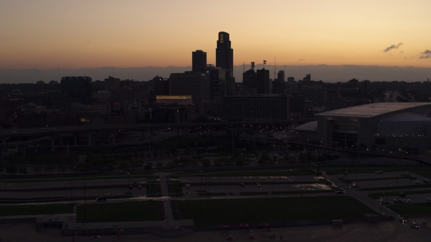 5.7K stock footage aerial video of the skyline, reveal arena and convention center at twilight, Downtown Omaha, Nebraska Aerial Stock Footage | DX0002_172_038
