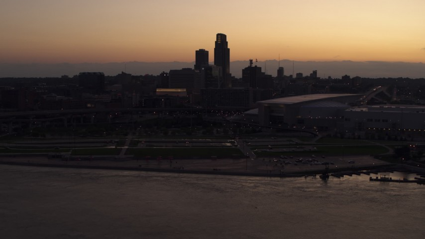 5.7K stock footage aerial video reverse view of the skyline, arena and convention center at twilight, Downtown Omaha, Nebraska Aerial Stock Footage | DX0002_172_039