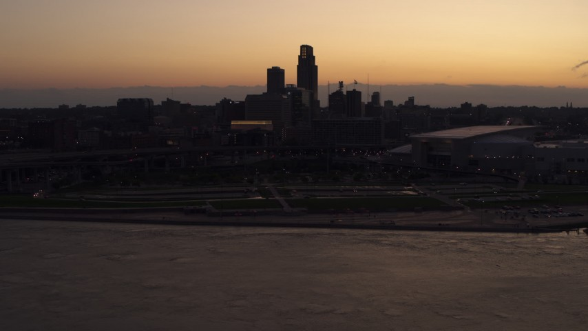 5.7K stock footage aerial video of the skyline, arena and convention center at twilight, Downtown Omaha, Nebraska Aerial Stock Footage | DX0002_172_040