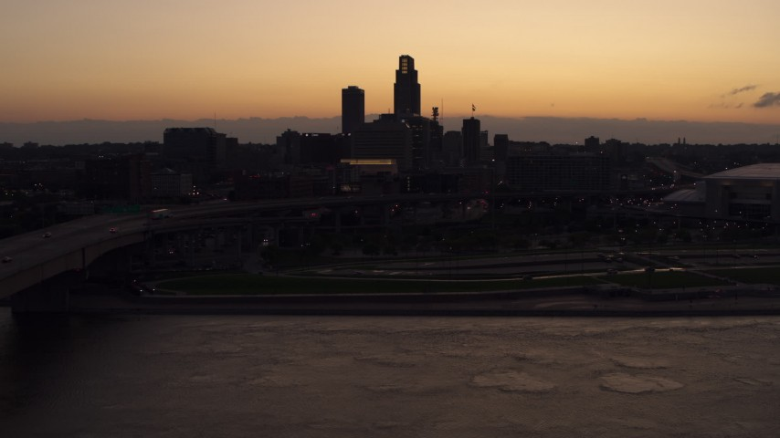 5.7K stock footage aerial video of a reverse view of the skyline at twilight, Downtown Omaha, Nebraska Aerial Stock Footage | DX0002_172_041