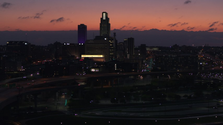 5.7K stock footage aerial video reverse view of skyscrapers in the skyline at twilight, Downtown Omaha, Nebraska Aerial Stock Footage | DX0002_173_002
