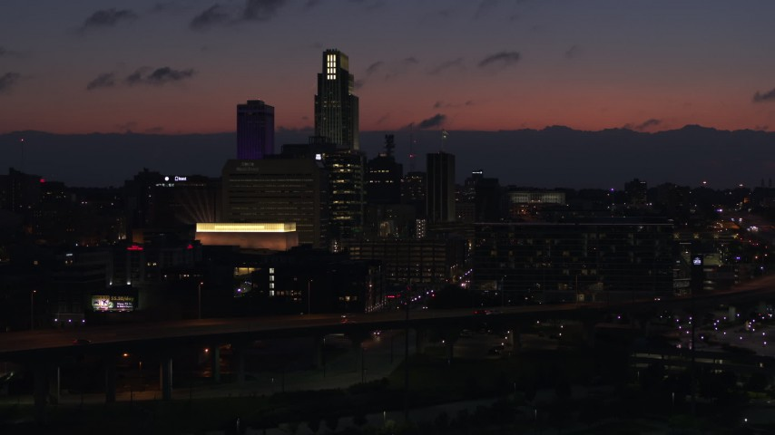 5.7K stock footage aerial video of ascending toward the city's skyline at twilight, Downtown Omaha, Nebraska Aerial Stock Footage | DX0002_173_007