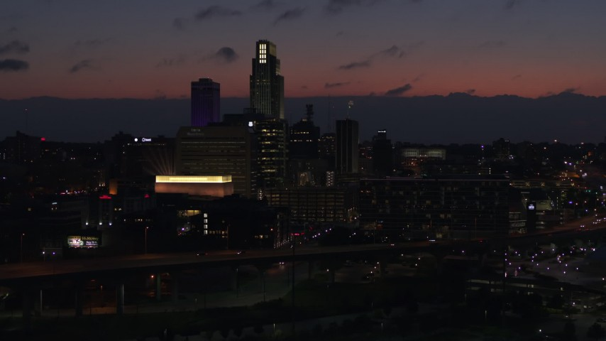 5.7K stock footage aerial video of flying away from the city's skyline at twilight, Downtown Omaha, Nebraska Aerial Stock Footage | DX0002_173_008