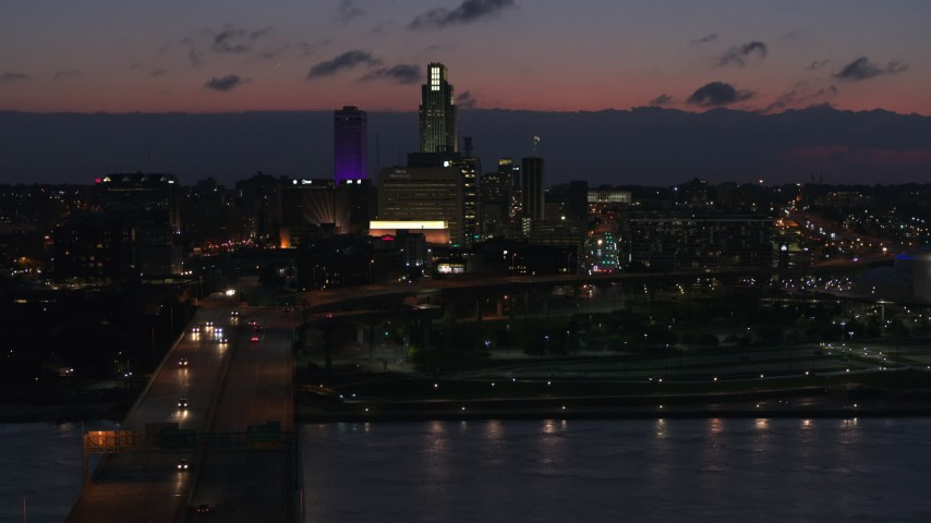 5.7K stock footage aerial video of a view of the city's skyline at twilight, seen from the river, Downtown Omaha, Nebraska Aerial Stock Footage   DX0002_173_010