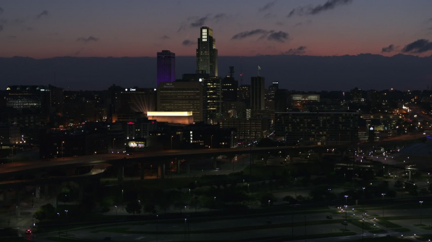 5.7K stock footage aerial video flyby the city's skyline at twilight, Downtown Omaha, Nebraska Aerial Stock Footage | DX0002_173_011