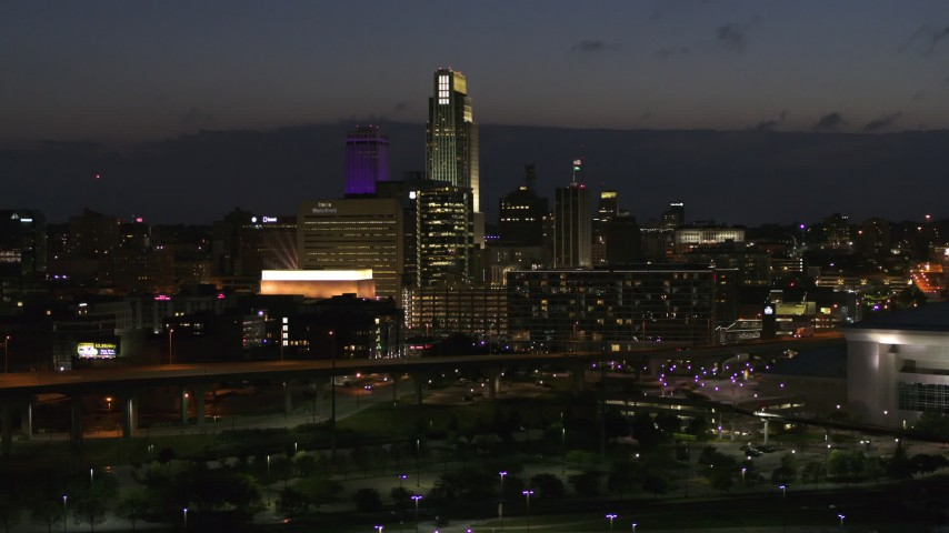 5.7K stock footage aerial video of slowly flying by the city's skyline at twilight, Downtown Omaha, Nebraska Aerial Stock Footage | DX0002_173_014