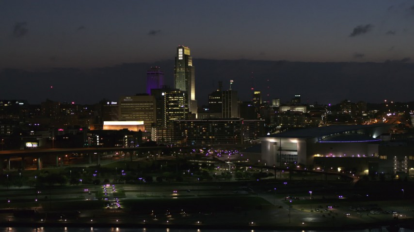 5.7K stock footage aerial video of passing by the city's skyline at twilight, Downtown Omaha, Nebraska Aerial Stock Footage | DX0002_173_015