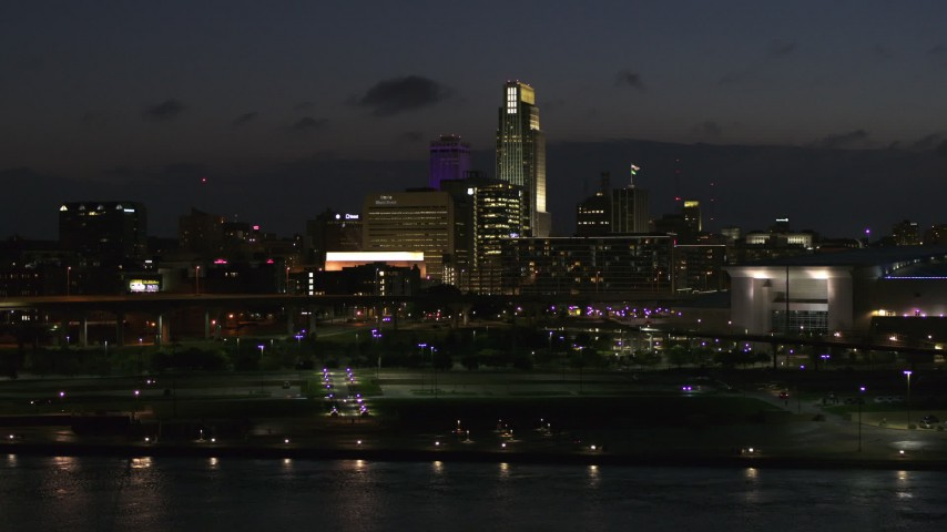 5.7K stock footage aerial video ascend and fly past the city's skyline at twilight, Downtown Omaha, Nebraska Aerial Stock Footage | DX0002_173_017