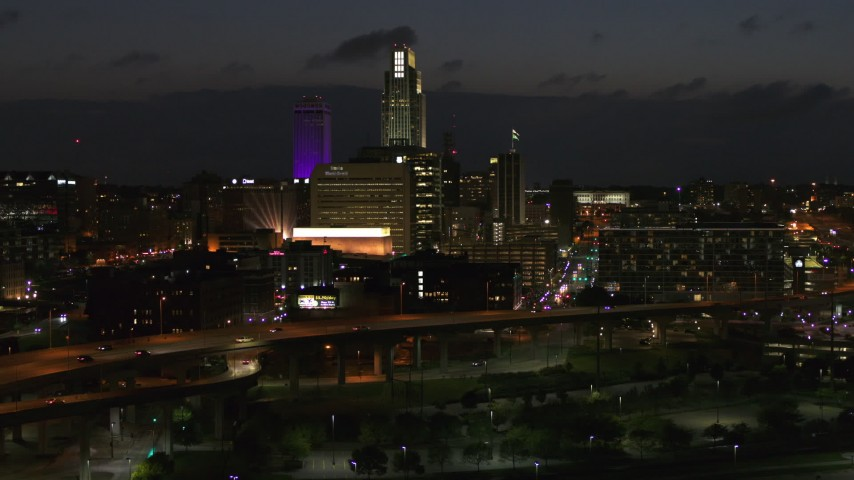 5.7K stock footage aerial video approach the city's skyline at twilight, Downtown Omaha, Nebraska Aerial Stock Footage | DX0002_173_018