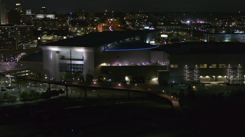 5.7K stock footage aerial video ascend and orbit arena and convention center complex at night, Downtown Omaha, Nebraska Aerial Stock Footage | DX0002_173_030